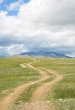 Road in the mountain steppes Stock Photo