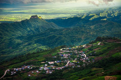 Road on mountain and village. Road curve on mountain And farmland agriculture and village at Asia stock photos