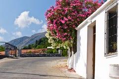 Road through mountain village, island of Crete Stock Photo