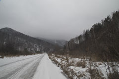 The road in the mountainous area in the winter. Royalty Free Stock Image