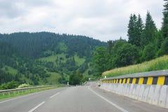 Road through mountains Stock Photography