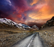 Road in mountains. With dramatic sky royalty free stock photography