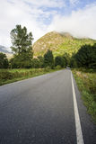 Road in the mountains. Paved road in the mountains Stock Images