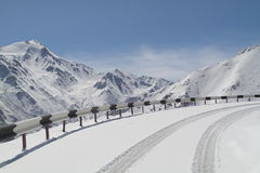 Road in the mountains. The road in the mountains in winter Stock Photography