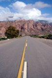 Road through the Mountains. A paved road through the mountains in South America Stock Photography