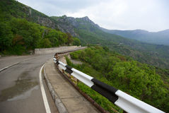 Road in mountains. At rainy day Royalty Free Stock Photos