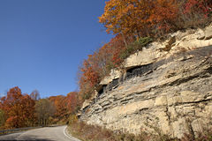 Road through mountains Appalachia. Road running through mountains in Appalachia. Rock shows different layers of rock formed stock image
