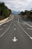 Road in mountains. Asphalt road going from mountains Stock Image