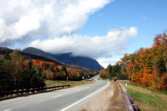 Road and mountains in autumn Stock Photo