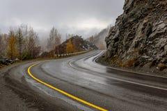 Road mountains autumn fog curve Royalty Free Stock Photo