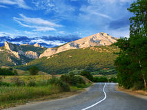 Road, mountains and blue sky Stock Photography