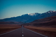 Road in the mountains. Chui tract, Kuray Mountains Royalty Free Stock Images