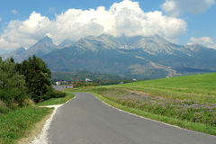 Road, mountains and clouds in Slovakia. Royalty Free Stock Photos