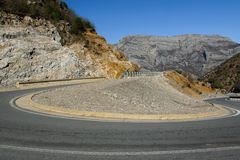 Road in the mountains with the 360 degree curve. Space for text Stock Image