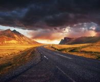 Road in mountains. Fantastic autumn landscape. Bridge over a cha. Nnel connecting Jokulsarlon Lagoon and Atlantic Ocean in southern Iceland Stock Images