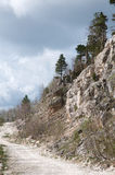 Road in mountains. Features stone road along the hillside Royalty Free Stock Photo