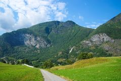 Road in mountains in Flam, Norway. Country road on mountain landscape. Beauty of nature. Hiking and camping. Summer trip Stock Images