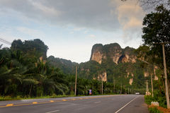 Road in mountains. Highway in tropical mountains. Sunset Stock Photo