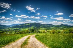 The road through the mountains. Holidays in the mountains a hot summer day, get some  fresh air woodland walks ideal place to regeneration Royalty Free Stock Photos