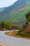 Ledge road. Road in the mountains of Jijel with speed limitation sign,  Algeria Royalty Free Stock Photos