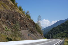 Road in the mountains of Krasnaya Polyana. In Sochi Stock Images