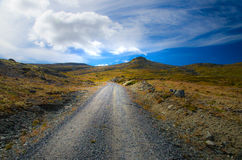 Road into the mountains. Road leading into the norwegian mountains in early autumn stock images