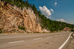 Road in the mountains of Montenegro. An empty road in the mountains of Montenegro on a sunny day Royalty Free Stock Photo