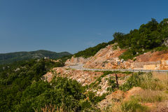 Road in the mountains of Montenegro. On a sunny day Stock Photo