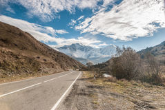 Road in the mountains. Nature, travel, Caucasus, Ossetia, Fiagdon, mountains, rocks, valley, snow, sky, clouds, road Royalty Free Stock Photos