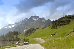 Road and mountains near Sankt Anton am Arlberg, Austria.  Royalty Free Stock Image