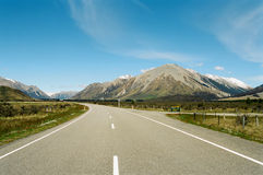 Road through mountains, New Zealand. Arthurs pass road through the south island Alps of New Zealand royalty free stock image