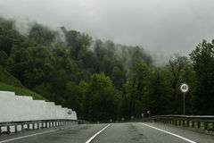 Road in the mountains in the rain in Sochi. Road in the mountains in the rain Stock Images
