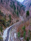 Road through mountains. Road through the mountains during winter time Royalty Free Stock Image