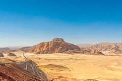 Road and Mountains in the Sinai desert Royalty Free Stock Images