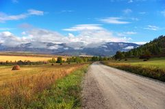 Road, mountains and skies. Stock Image