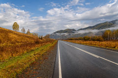 Road mountains sky asphalt autumn Stock Image