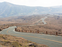 Road with mountains and storm clouds Royalty Free Stock Images