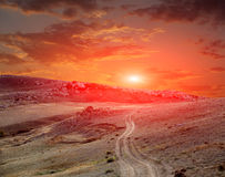 Road in mountains on sunset Royalty Free Stock Photo