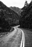 Road and mountains in the Tasmanian countryside. Black and white Royalty Free Stock Image