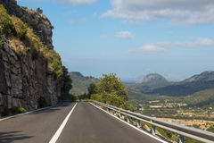 Road in mountains to a town Stock Photography