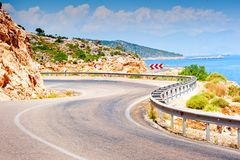 Road in the mountains turns sharply over mountain Royalty Free Stock Photos