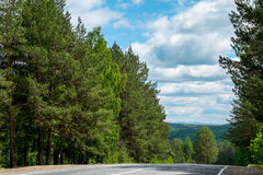 Road in the mountains of the Urals. Royalty Free Stock Image
