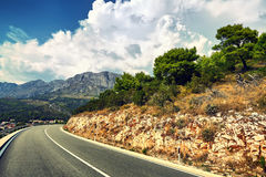 Road in mountains. Vintage style. Instagram filter. Stock Photos