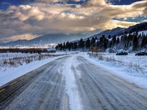 Road through mountains. At winter time Stock Photos