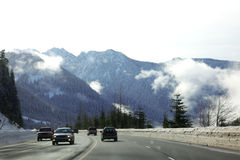 Road through Mt,  cold winter in Montana Stock Photography