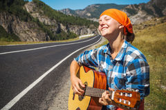 On the road with music Stock Photo