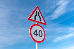 Road narrows and Speed limit Royalty Free Stock Image