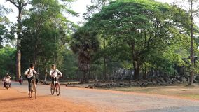 Road near Angkor Thom temple complex in Siem Reap, Cambodia. CAMBODIA, SIEM REAP, APRIL 3, 2014: Road near Angkor Thom temple complex in Siem Reap, Cambodia stock video footage