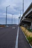 The road near the bridge. Gloomy overcast autumn day Stock Images