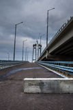 The road near the bridge. Gloomy overcast day Royalty Free Stock Photos